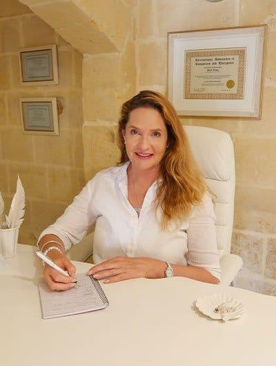 Karin Laing in her therapy studio at L'Gharix Temple Retreat Gozo Malta