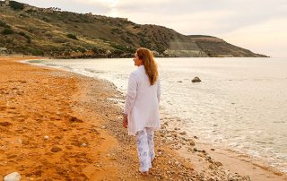 Karin Laing - feelings of self-empowerment - walking on the beach in Gozo